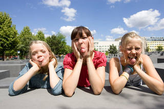 Three teenage girls making funny faces