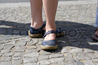 Girl with a pair of blue shoes