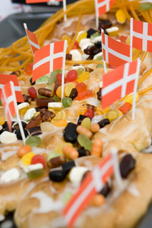 Close up image of traditional danish birthday cake with danish flags and sweets
