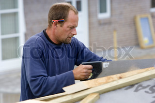 A carpenter building a carport