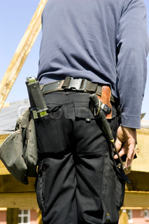 Male carpenter with his carpentry tool belt