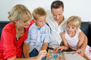 A family in vacation playing a board game