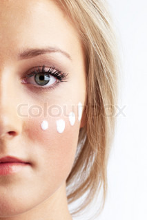 Cropped image of teenage girl with cream on her face