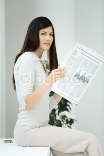 Image of 'newspaper, woman, business women'