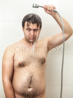 depressed fat hairy man having shower