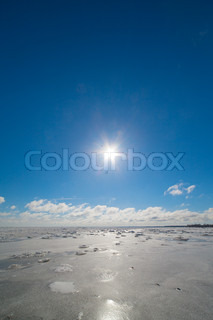 Sunshine over frozen Baltic sea.