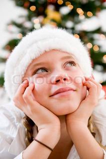 A teenage girl wishing for Christmas presents