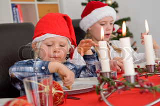 Caucasian children enjoying Christmas lunch