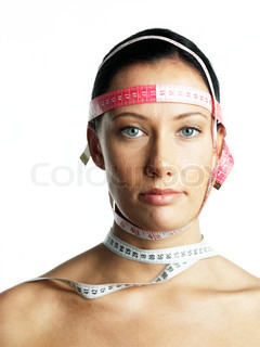 Portrait of a woman with tape measure around her face