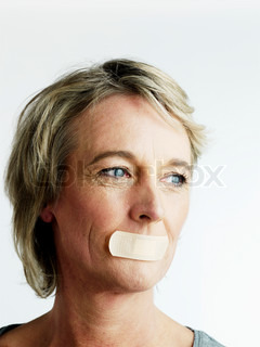 A matured woman with an adhesive tape on her mouth