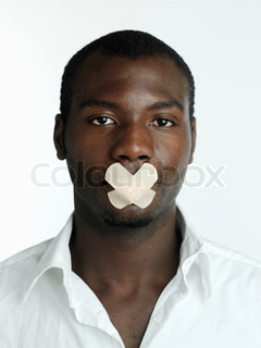 A black man with adhesive tapes on his mouth