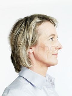 Image of 'profile, woman, serious'