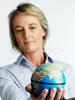 Blurred image of a woman looking at a globe
