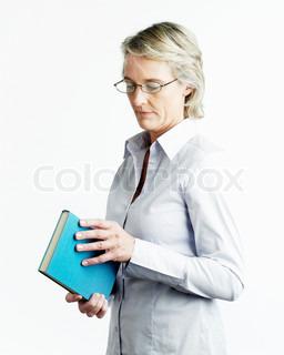 A female professor holding a book