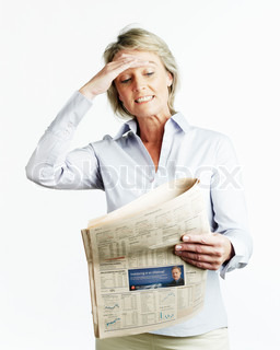 A businesswoman worried about the news she read on the papers