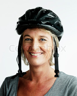 A smiling woman with a bicycle helmet