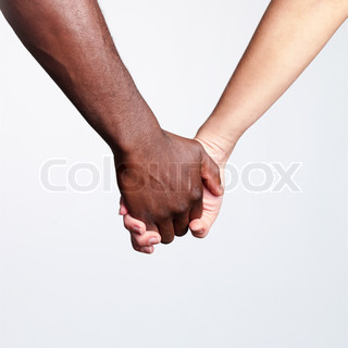 Cropped image of a mixed-race couple holding hands