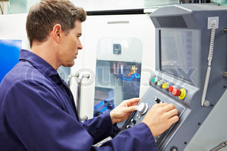 Engineer Operating Computer Controlled Milling Machine
