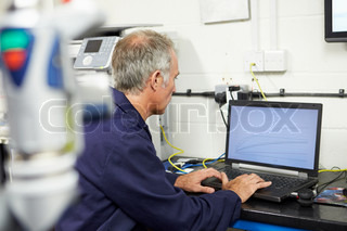 Engineer Using Computerized CMM Arm In Factory
