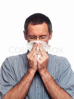 A sick middle-aged man blows his nose