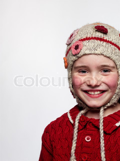 A smiling girl with knitted hat