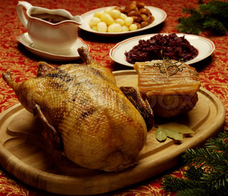 Traditional danish Christmas food - roast duck and pork with brown potatoes and red cabbage