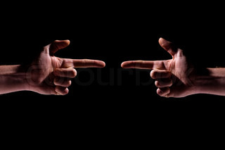 Two hands pointing at each other over black background