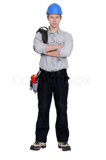 Angry tradesman with crossed arms