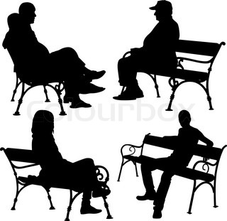 silhouettes of man and woman sitting on the park bench