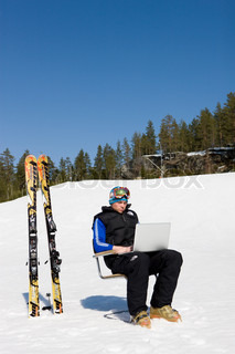 Relaxing with a laptop at Kongsberg ski center Norway