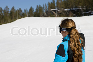A woman ready  to ski