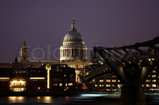 St. Paul's cathedral and the Millenium bridge in London at night