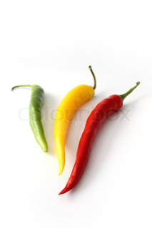 Red, yellow and green chilies with white background