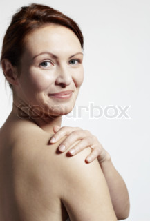 Portrait of a smiling woman with bare shoulders