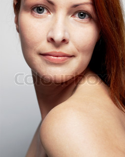 Cropped portrait of a red-haired woman