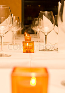 Candelight on a formal table setting