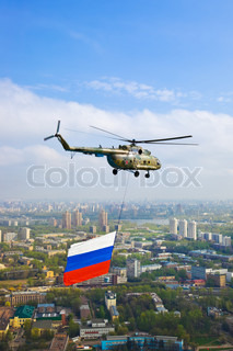 Helicopter with russian flag over Moscow at parade of victory day