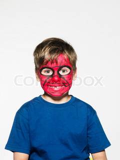 Boy with blue shirt painted as spiderman