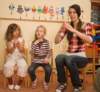 Children in kindergarten learn to sing with their teacher