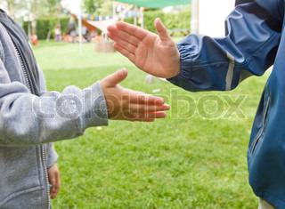 Cropped image of children's hands clapping