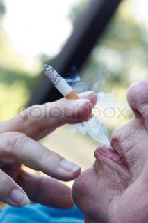An elderly woman smoking a cigarette