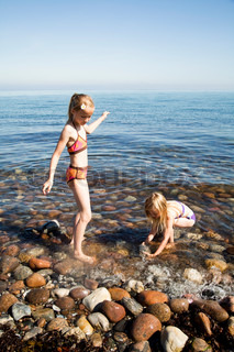 Caucasian girls enjoying the summer  heat in the beach