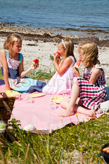 Caucasian girls having summer picnic in the beach