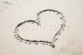 Heart drawn on the sand