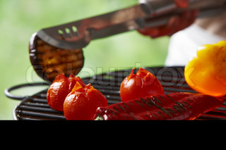 Barbecuing pepper fruit,aubergine and tomatoes