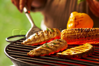 Grilling meat, bell pepper, corn  and pineapple