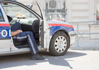 Cropped image of Austrian police in a car