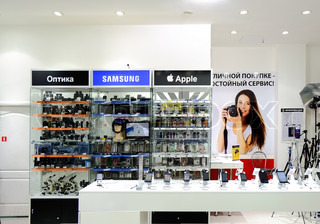 ASTRAKHAN, RUSSIA - JULY 01, 2014: Local photo and mobile devices store. Apple and Samsung devices near each other.