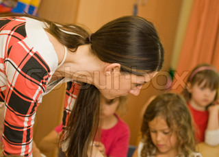 Kindergarten teacher with young children