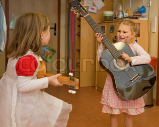 Young girls playing the guitar